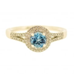 Aquamarine and diamond halo platinum ring
