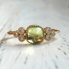 Cabochon peridot Ring with Diamond Trefoil Accents