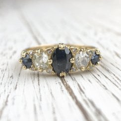 Edwardian craved half hoop ring with sapphires and diamonds