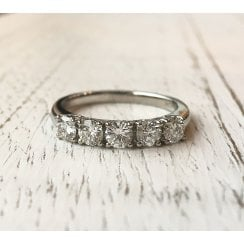Five diamonds platinum ring