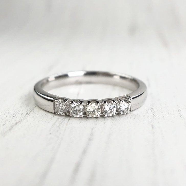 Five Diamonds Straight Band in White Gold