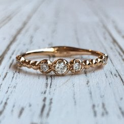 Graduated Diamond half eternity Ring in Rose Gold