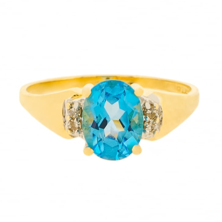 Intense Blue Topaz with Diamond Sides ring