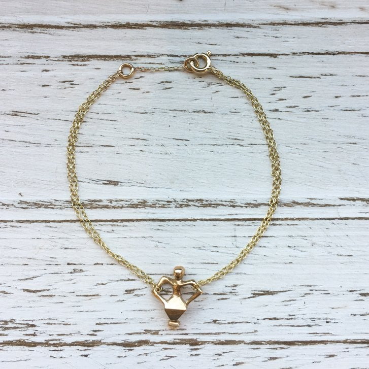 Issy White Bronze and Gold Dancing man bracelet