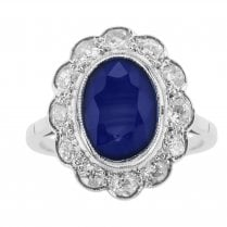 Large Oval Sapphire and Diamond Halo Ring