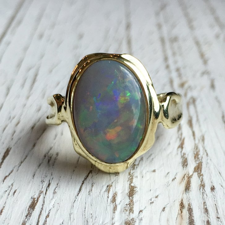 organic French ring with semi-black opal