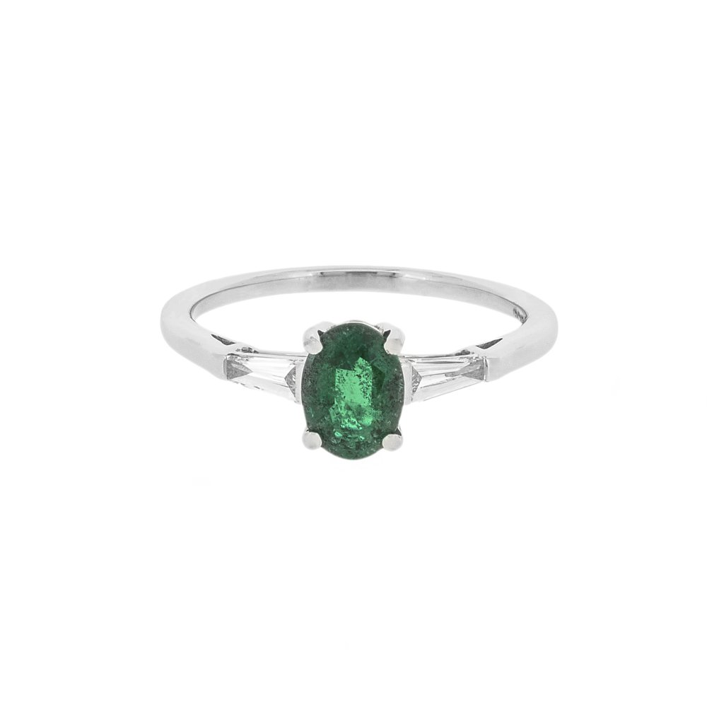 oval emerald and tapered baguette diamonds ring