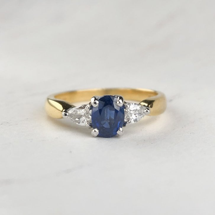 Oval Sapphire Ring with pear shaped Diamond shoulders