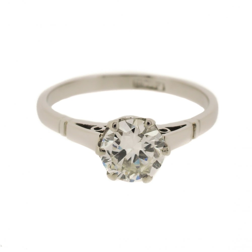 platinum scrolled solitaire ring