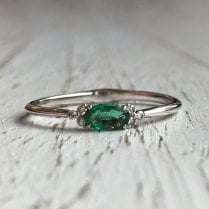 Dainty oval Emerald and Diamond Accents Ring in White Gold