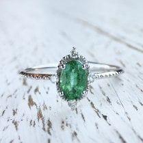 Emerald within Diamond North Star Frame Ring