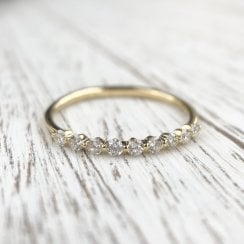 Richard woo floating diamonds half eternity band in yellow gold