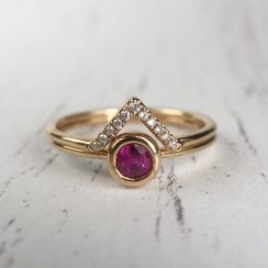 Richard Woo Set ring with ruby and shaped diamond band