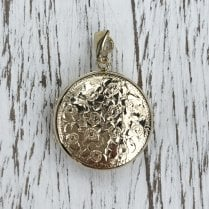 Round gold locket engraved with forget-me-nots