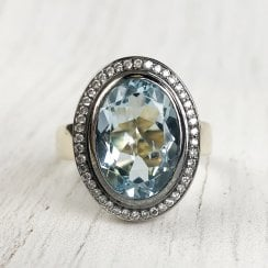 Solid gold Oval Aquamarine and Diamond Cocktail Ring