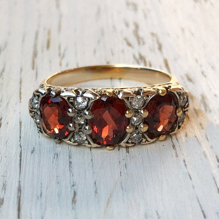 Three Garnet and Diamond Ring with Ornate Bridge